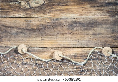 Fishing net on old wood, maritime nautical background texture.