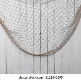 fishing net on a white wooden background.Background  for text or image.
