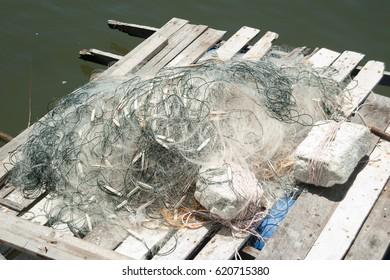 Fishing net on wooden jetty.