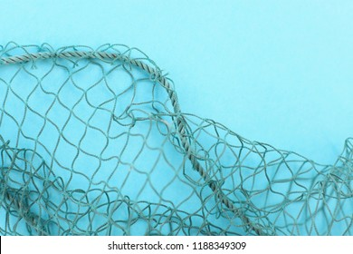 Fishing net with space for your text. Blue background for a fishery theme.