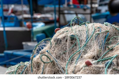 Fishing net standing in front of fishing boats, izmir Turkey - Shutterstock ID 1893067237
