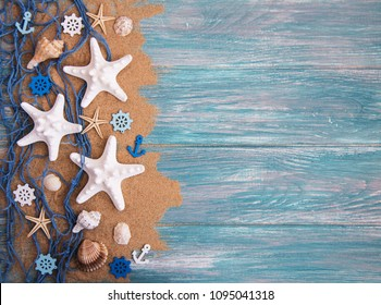 Fishing net with starfish on a  wooden  background