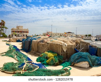 Fishing nets and boats in the port in the mediterranean sea