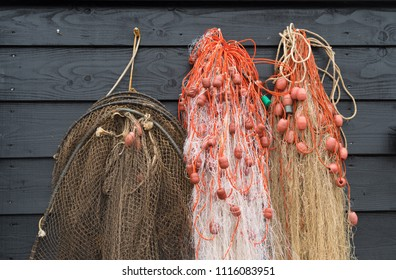 fishing nets hanging on a wooden wall