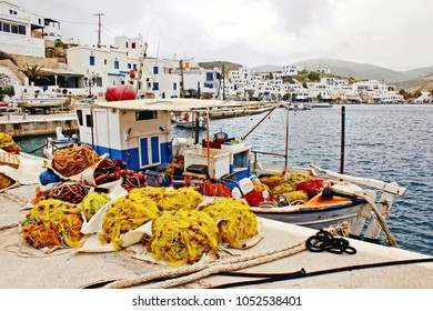 Fishing nets at the harbor of Panormos, a fishing village in Tinos island, Cyclades, Greece.