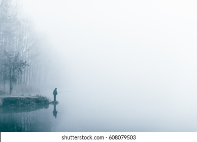 Fishing on the lake. Fog. Minimalism