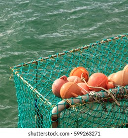 fishing orange buoy and green nets, location - North Island, New Zealand