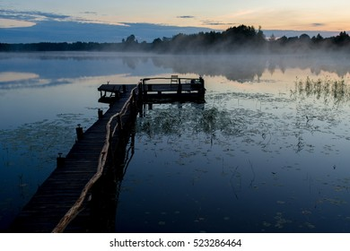 Fishing pathway, foggy lake in the morning, Belarus, Summer