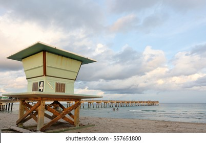 Fishing Peer at Dania Beach at Sun Set with Palm Trees at Foreground, Fort Lauderdale, Florida, USA.