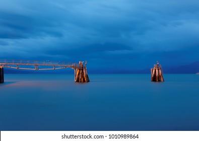 Fishing Pier after sunset at Homer, Alaska, USA. Homer is a small city on Kachemak Bay, on Alaska's Kenai Peninsula. Homer Spit is a long strip of land with shops, restaurants and beaches