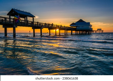 Fishing pier in the Gulf of Mexico at sunset,  Clearwater Beach, Florida.