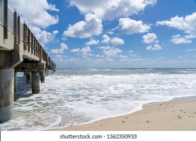Fishing Pier in Lake Worth Florida, USA on the Atlantic Ocean. It is a late winter day