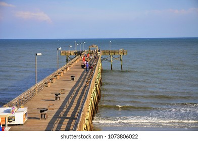 Fishing pier stretches out into the ocean.