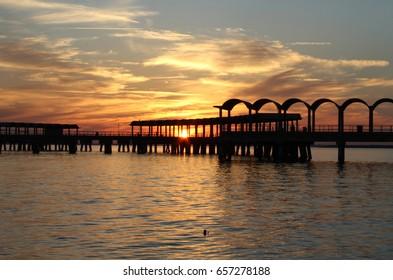 Fishing pier at sunset at Jekyll Island, Georgia.
