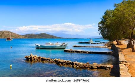 Fishing and pleasure boats off the coast of Crete. Elounda, Crete, Greece, Europe