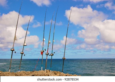 Fishing Poles with Ocean Background