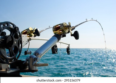 Fishing Poles on Boat. Picture of two fishing poles in rod holders on the back of a boat.