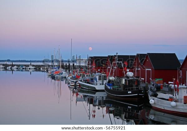 Fishing port Boltenhagen / Tarnewitz (Baltic Sea) at sunset on full moon