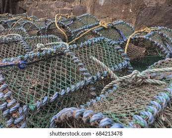 Fishing pots piled on the dock