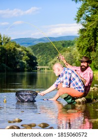 Fishing and recreation. big game fishing. Two male friends fishing together. fly fish hobby of men. retirement fishery. happy fishermen friendship. retired dad and mature bearded son.