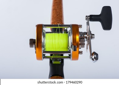 the fishing reel for fishing isolated over white