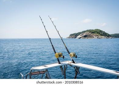 Fishing reels and rods reels for big game fishing trolling tuna.Big trawler fishing in the hot sea, blue sky and blue water.Andaman sea fishing, Phuket, Thailand.