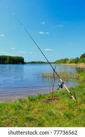 Fishing rod by the lake. Fishing scene.