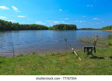 Fishing rod and folding chair by the lake