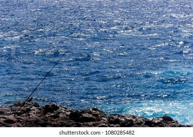 Fishing rod isolated on sea background.