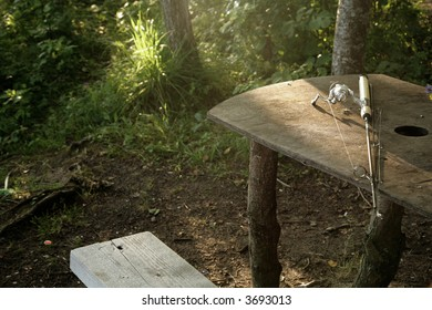 fishing rod lying on table in forest