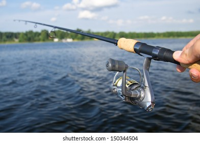 Fishing with rod on lake