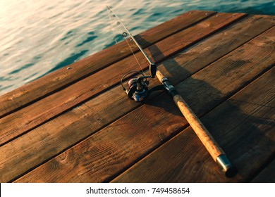 Fishing rod on a wooden dock.