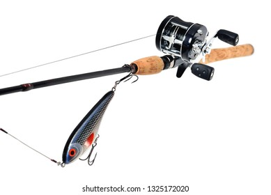 fishing rod, reel, wobbler, braided fishing line metal leash jerk, white background, close-up, place for inscription