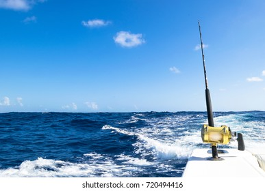 Fishing rod in a saltwater fishing boat during fishery day in blue ocean