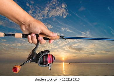Fishing rods   handle   Hold on the white background.