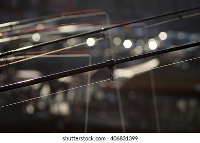 Fishing Rods and Fishing Lines with Bokeh Background