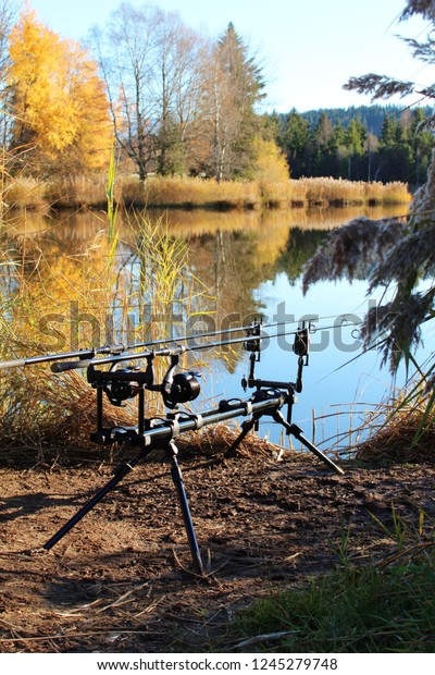 Fishing rods at a little lake in fall, Bavaria, Germany