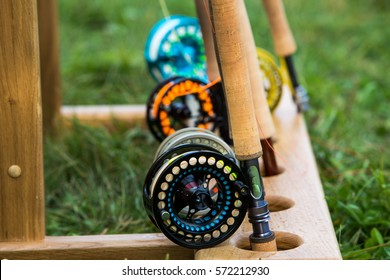 fishing rods with reels for fly fishing on a wooden stand