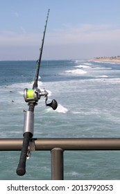 fishing rods with reels in front of the river
