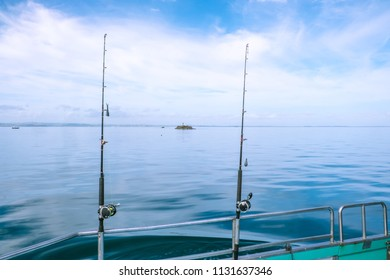 Fishing rods with sinkers and reels on a charter boat on calm, tranquil sea in Far North District, Northland, New Zealand, NZ