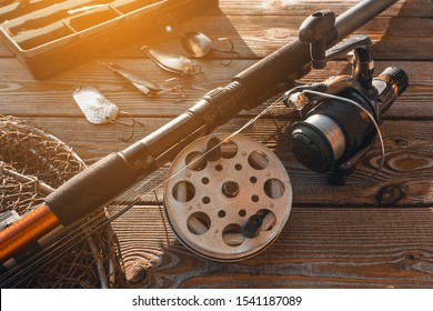 fishing rods and tackles on the wooden background