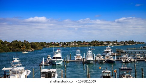 Fishing and sailboats docked in a harbor in Jupiter, Florida
