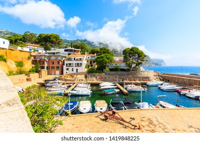 Fishing and sailing boats in picturesque port of Fornells village, Costa Brava, Spain