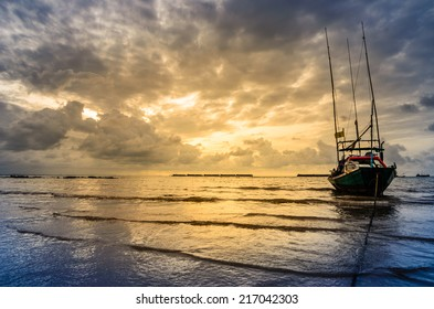 Fishing sea boat and Sunrise clouds before strom in Thailand blue  light tone