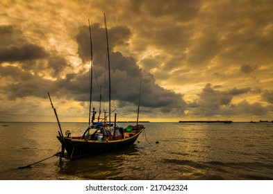 Fishing sea boat and Sunrise clouds before strom in Thailand gold light tone