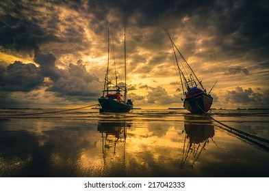 Fishing sea boat and Sunrise clouds before strom in Thailand gold light tone vintage