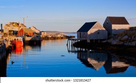 Fishing shacks, boat and buildings at iconic Peggys Cove, Nova Scotia, Canada.