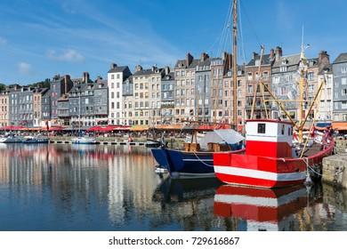 Fishing ship in old medieval harbor of Honfleur, France