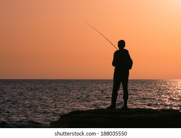Fishing silhouette at sunset sunrise
