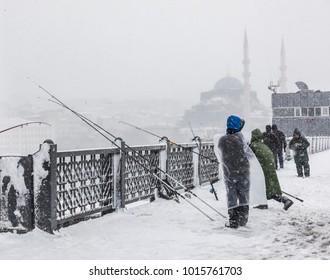 Fishing at Snowy weather at Istanbul Galata Bridge